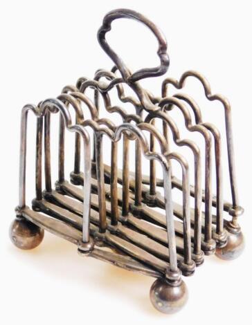 An early 20thC fold away Concertina action toast rack