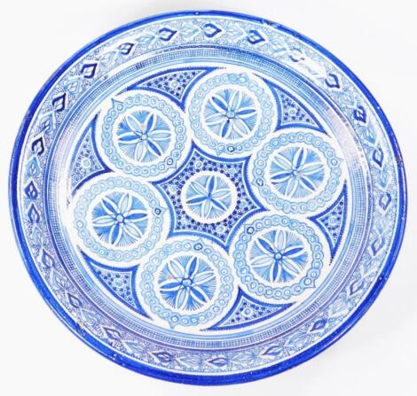 A 17thC style Islamic pottery blue and white charger