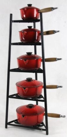 A graduated set of Le Creuset French saucepans
