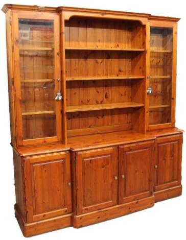 A Ducal pine breakfront display cabinet