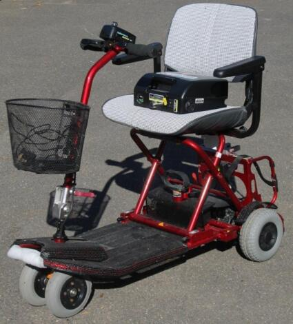 A four wheel shop mobility scooter