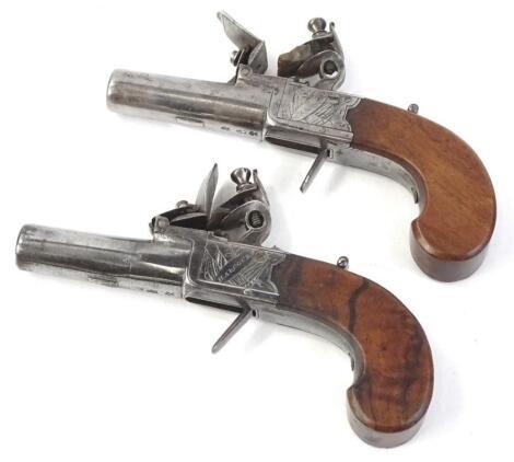 A pair of 19thC flintlock pistols