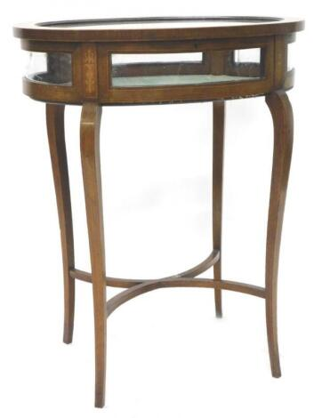 An Edwardian mahogany and marquetry oval display table