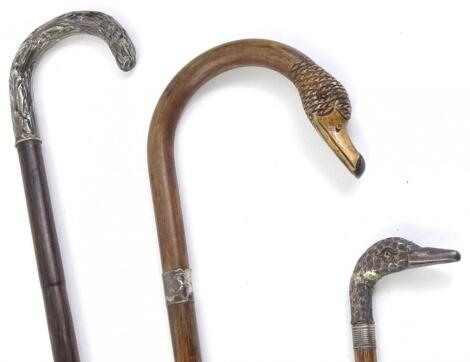 Three late 19thC/early 20thC walking canes