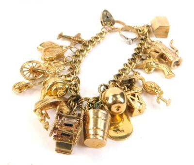 A 9ct gold and yellow metal charm bracelet