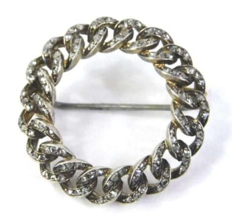 A circular bar brooch