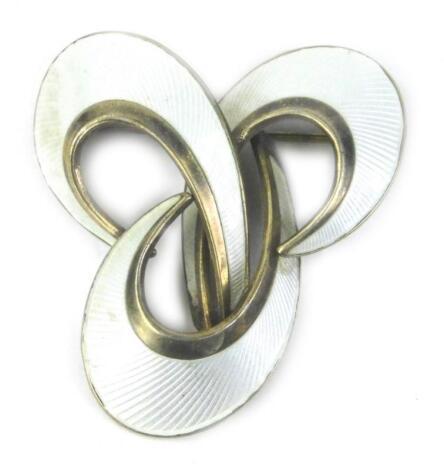 A Scandinavian silver gilt and white enamel three spray brooch