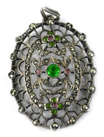 A Victorian style silver plated and marcasite set oval pendant