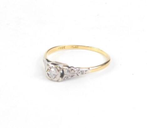 An 18ct gold and platinum diamond set dress ring