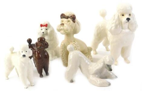 A collection of Beswick and other ceramic poodles