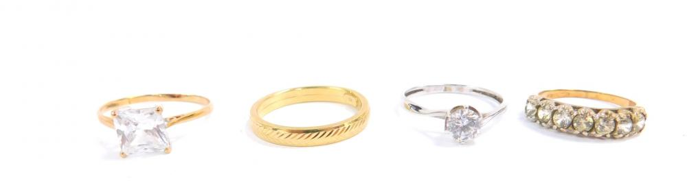 Three 9ct gold and gem set rings, together with a 9ct gold wedding band...