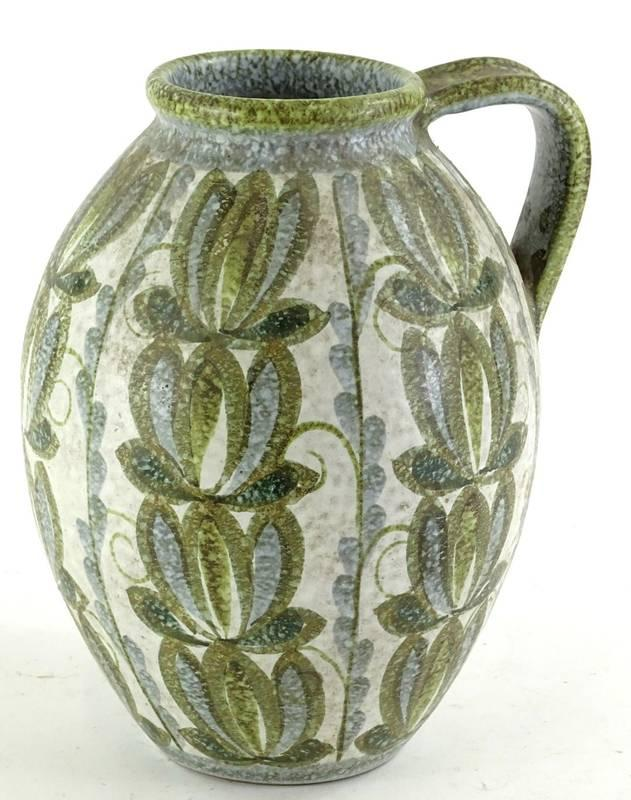 A Denby studio ware stoneware lotus shaped flagon, decorated with stylised...