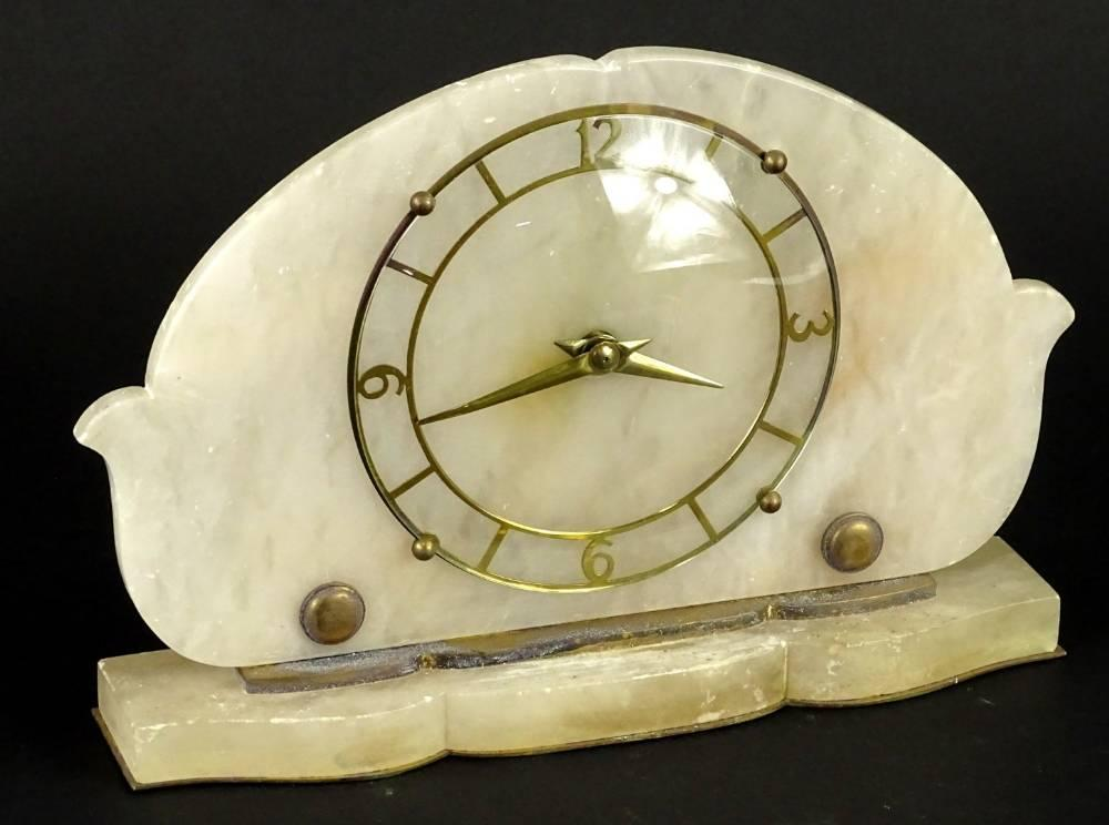A 1950's alabaster and brass timepiece, with a shaped case, 18cm H...