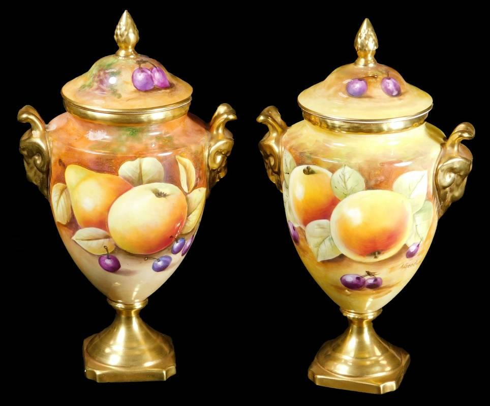 A pair of 20thC Coalport porcelain fruit pattern lidded vases, by Alexandra...