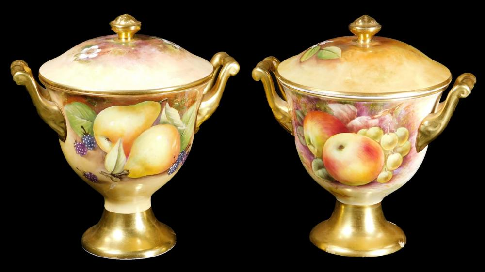 A pair of 20thC Coalport porcelain lidded vases, by Richard Budd, each with...