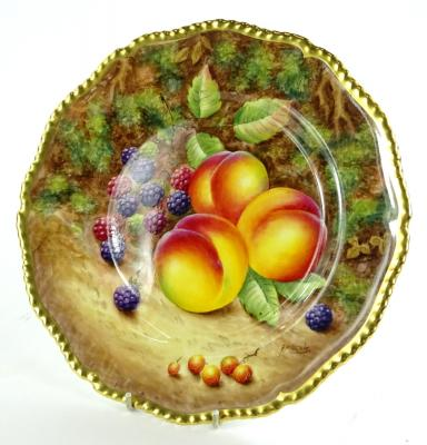 A Royal Worcester porcelain plate, decorated with fruit by F Higgins, with gilt borders, printed marks in black to underside, 27cm dia.