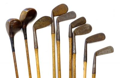 An associated set of hickory shafted golf clubs, to include two drivers, wedges, various makers and owners stamps to include Fred Smythe Royal Dublin, F.W Hall etc. Provenance: Formally the property of Sam King (1911-2003) member of the British team to play the USA in the Ryder Cup in 1937, 1947 and 1949. He presented the clubs to Cedric H Blackbourne, his old friend when he was at Kenwick Park Golf Club near Louth etc.
