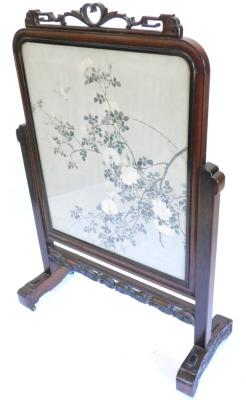 A late 19th/early 20thC Chinese hardwood screen, the frame carved with scrolls and with a pierced crest, the banner decorated with birds, flowering branches etc., 123cm H, 81cm W. Provenance: The property of Joan Stephenson, Kirkwood, North Church Walk, Newark, Nottinghamshire.
