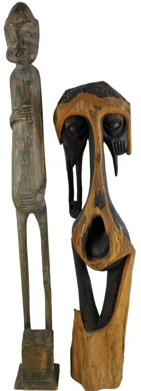 A 20thC African Tribal totem style figure, in standing pose, with elaborate...