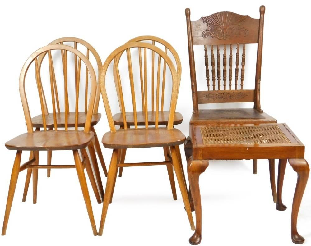 A set of four vintage Ercol light elm hoop back dining chairs, with stick...
