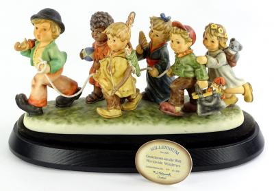 A Hummel figure group made for the Millennium, titled Worldwide Wonder, limited edition number 0279 of 2000, sold with original plinth, presentation plaque and box etc.