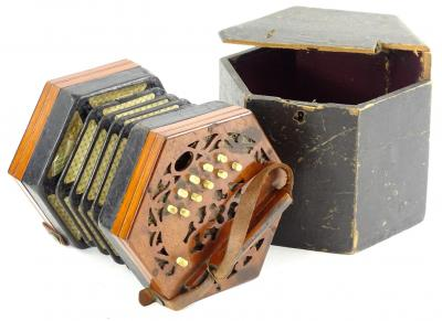 A 19thC mahogany and canvas concertina or squeeze box, with various bone keys, stamped Steel Reeds, 19cm x 12cm, in fitted box, numbered 10094. (AF)