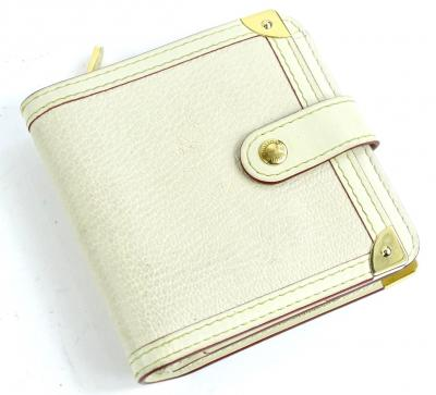 A Louis Vuitton Suhali leather bifold wallet, in white with brass zipper, stamped Louis Vuitton made in France to interior.