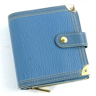 A Louis Vuitton leather bifold wallet, in blue, with brass zipper, stamped Louis Vuitton made in France to interior.