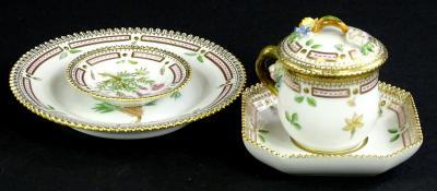 Four items of Royal Copenhagen Flora Danica porcelain, each piece with an elaborate pink and gilt border, to include a chocolate cup cover and square saucer.