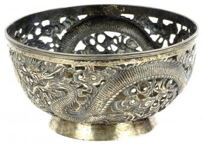A Chinese white metal bowl, with pierced decoration cast with dragons etc., signed to underside and numbered 90, 17oz, 19cm dia.