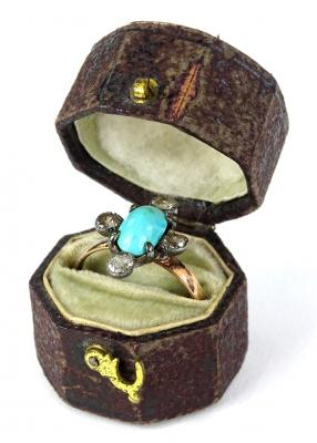 A Victorian dress ring, set with oval cut turquoise stone, and set with four old cut diamonds in cross shape, each in claw setting, on a yellow metal band, unmarked, ring size P, 2.5g all in.