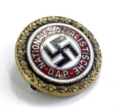 Withdrawn prior to sale. A Third Reich National Socialist gold membership pin badge, with engraved name Kurt Wolff, number 9050, also in raised stamp A.H. 1939, etc.
