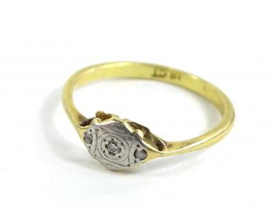 An 18ct gold and platinum dress ring, set with tiny diamonds, ring size O½, 2.2g all in.