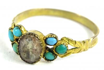 A gilt metal dress ring, set with turquoise shoulders and central white paste stone, with V shaped shoulders, ring size P, 1.1g all in.