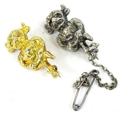 Two Imp brooches, to include a silver imp brooch, with safety chain, 2.5cm high, a 9ct gold imp brooch, 3cm high, 1.3g. (2)