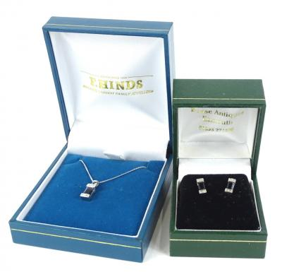A sapphire and diamond earring and necklace set, the pendant with rectangular cut sapphire and two pave set tiny diamonds to each end, white metal, unmarked pendant, on fine link chain, marked 375, 2.1g all in, and a pair of associated earrings, marked 375, with butterfly backs, 2.2g all in.