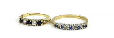 Two 9ct gold dress rings, comprising a half hoop eternity ring, set with blue and white stones and another set with five stones and heart shaped shoulders, 3.2g all in.