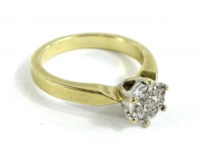 A 9ct gold dress ring, in the form of a flower and set with round brilliant cut diamonds, totalling approx 0.10cts and marked to inner band, ring size K½, 3.4g all in.