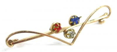 A tri-colour bar brooch, set with three paste stones, red, white and blue, on yellow metal thin frame, unmarked, 5cm W.