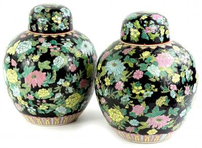 A pair of Chinese famille noire ginger jars, each decorated with brightly coloured flowers, in pink, green, turquoise etc., 30cm H.