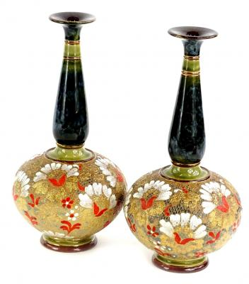 A pair of Doulton Lambeth Slaters patent bottle shaped vases, each decorated in red, gold and white with mottled green and blue necks, impressed marks to underside, 26cm H.
