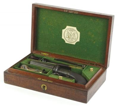 A mid 19thC pepperbox pistol, signed W.A. Beckwith of London, engraved with scrolls etc., finely incised mahogany handle and vacant oval cartouche, in fitted box, bearing makers paper label with some accessories etc., sold with original hand written letter with directions for loading the revolving pistol, signed Beckwith Gun Maker London etc.