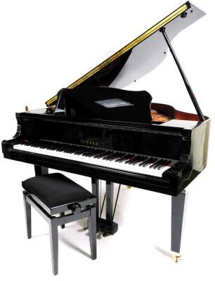 A Yamaha Baby Grand piano, in black with adjustable music rest, no. KJ 2737432 GB1 stamped Yamaha Corporation, 145cm W, 157cm D.