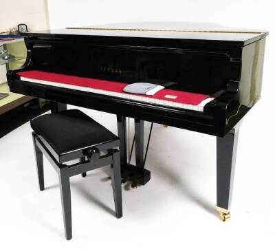 A Yamaha Baby Grand piano, in black with adjustable music rest, no. KJ 2737432 GB1 stamped Yamaha Corporation, 145cm W, 157cm D. - 2