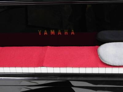 A Yamaha Baby Grand piano, in black with adjustable music rest, no. KJ 2737432 GB1 stamped Yamaha Corporation, 145cm W, 157cm D. - 3