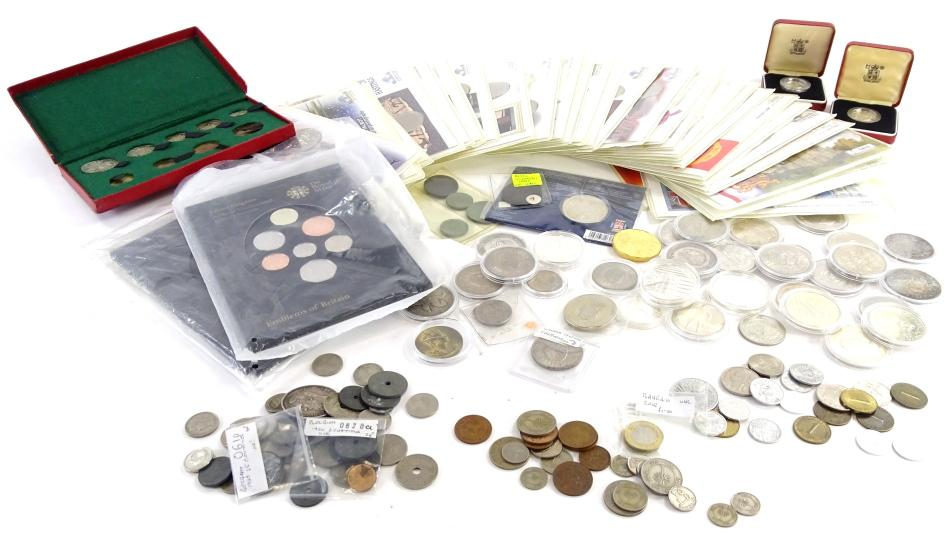 A collection of coins and medallions to be included in the sale.