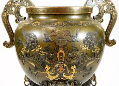 A fine Japanese two-colour patinated bronze koro, with gilt piquet work embellishments, silvered inlays and aplliques of coral and mother-of-pearl, the pierced and domed cover having Kylin surmount, dragon banded insert, the two-handle bulbous body with s - 6