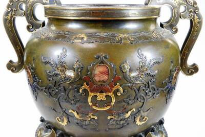 A fine Japanese two-colour patinated bronze koro, with gilt piquet work embellishments, silvered inlays and aplliques of coral and mother-of-pearl, the pierced and domed cover having Kylin surmount, dragon banded insert, the two-handle bulbous body with s - 7