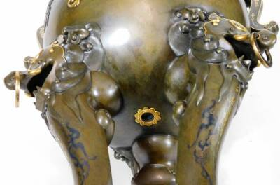 A fine Japanese two-colour patinated bronze koro, with gilt piquet work embellishments, silvered inlays and aplliques of coral and mother-of-pearl, the pierced and domed cover having Kylin surmount, dragon banded insert, the two-handle bulbous body with s - 11