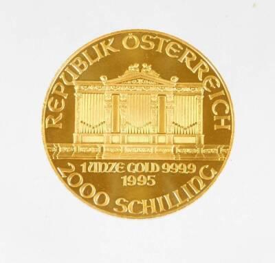 A 1995 Austrian gold Philharmonic coin, marked 1 unze gold, 999.9, 2000 Schilling.